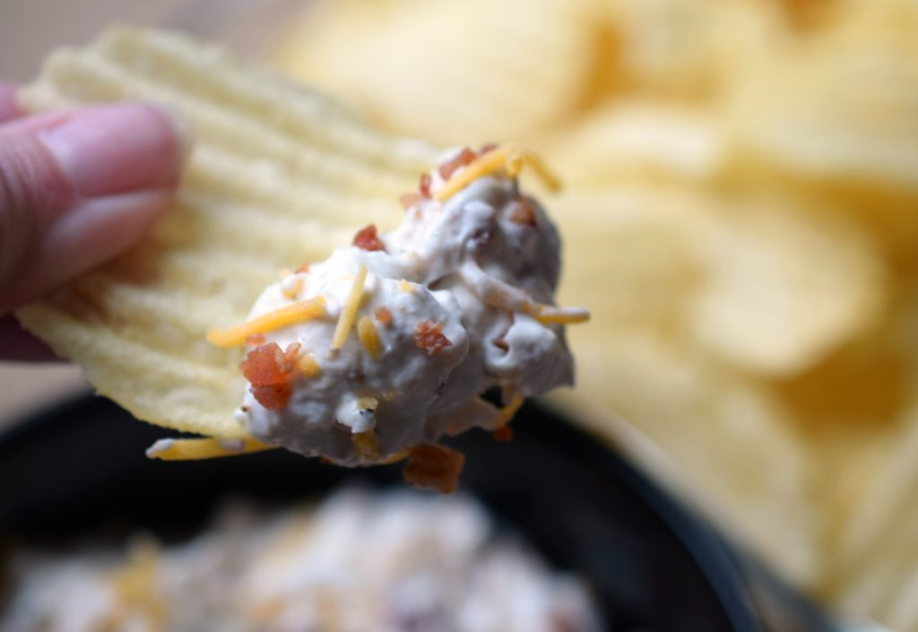 """You cannot go wrong serving Classy Bacon Cheddar Dip a.k.a. """"Crack Dip"""" at your next party. Bacon & cheese make this one irresistibly good dip!"""