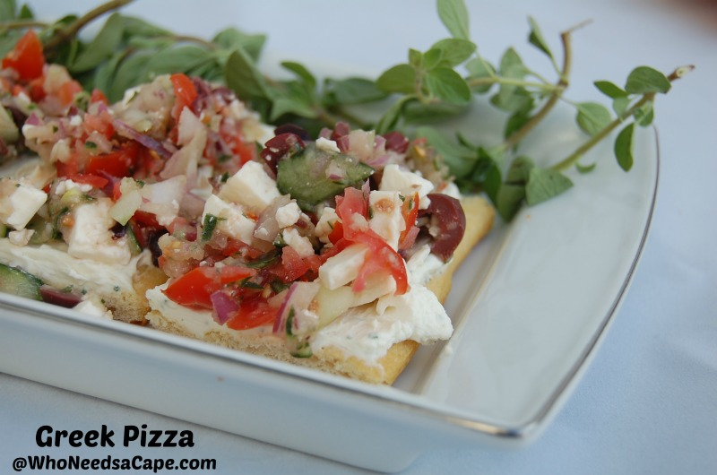 Greek Pizza is a wonderful appetizer. It's simple, beautiful, and delicious. Treat yourself to this amazing snack or meal tonight!