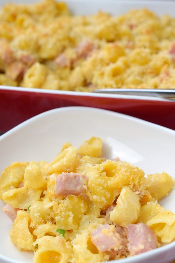 Here comes comfort food in the form of Baked Macaroni & Cheese with Ham. Use up that leftover holiday ham and make this homestyle cheesy dish.