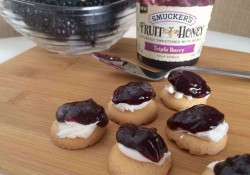 Kids coming home from school famished? Make these quick After School Snack Bites with Smucker's® Fruit & Honey atop cream cheese on a cookie.