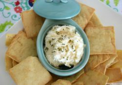 Next time you need an appetizer in a hurry, whip up this flavor packed Roasted Garlic Parmesan Dip. Creamy with delicious flavors, perfect for a crowd.