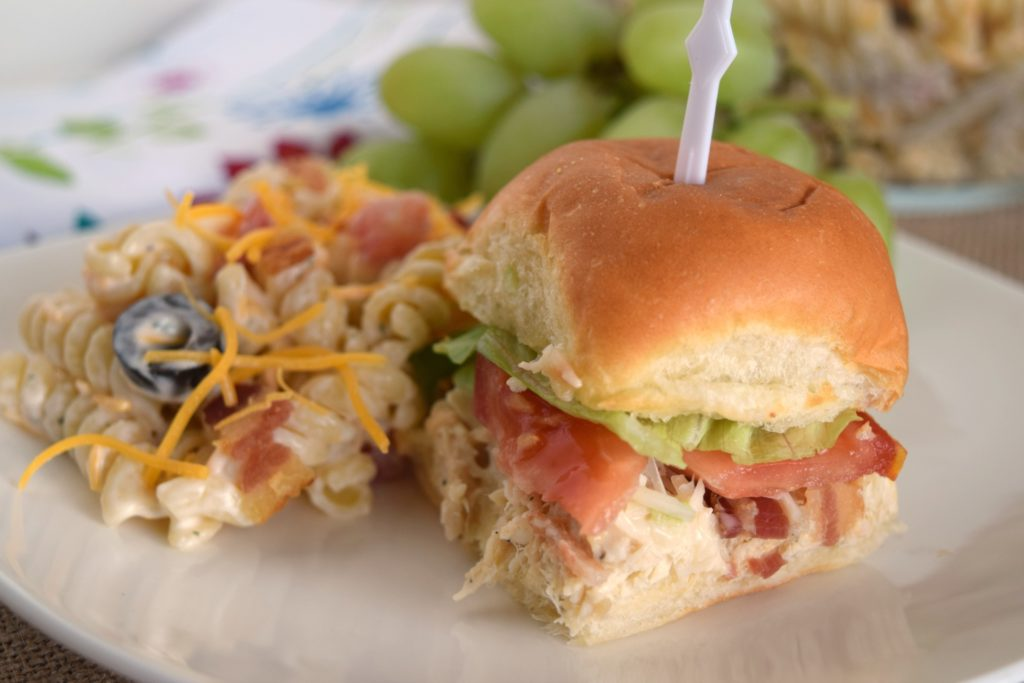 Bacon Caesar Chicken Sliders are so delicious! Layers of seasoned chicken, bacon, lettuce, tomato on buttery rolls, perfect for parties or tailgating.