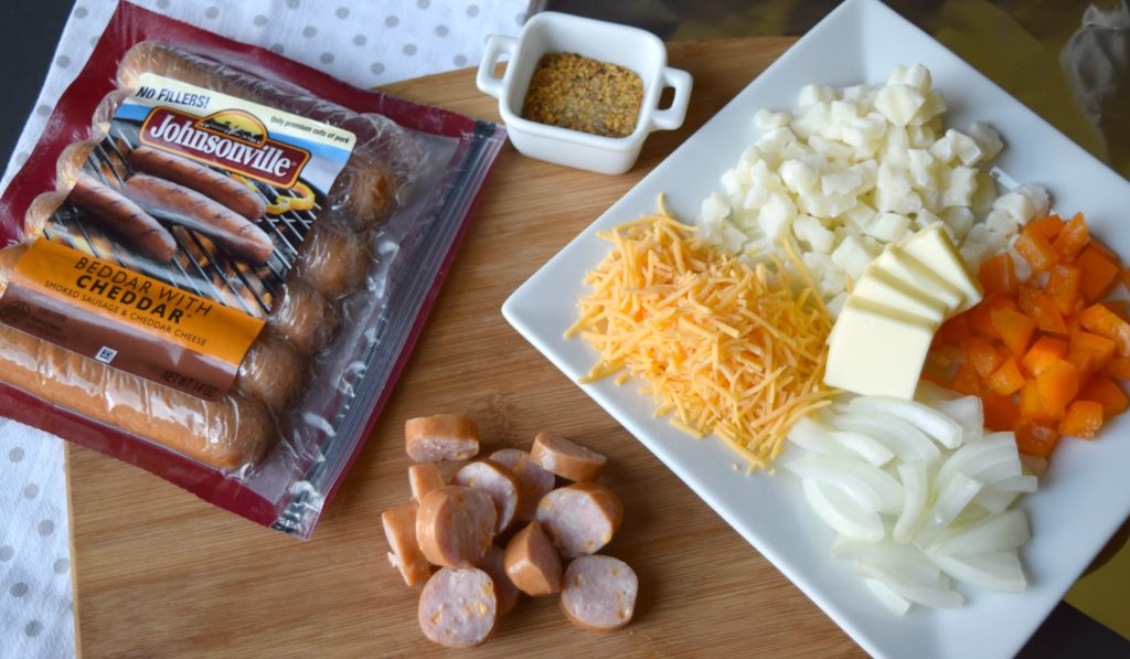You'll love this flavorful Cheesy Potato & Sausage Foil Packet! Perfect for camping, or grilling the flavors blend together to make a great meal.