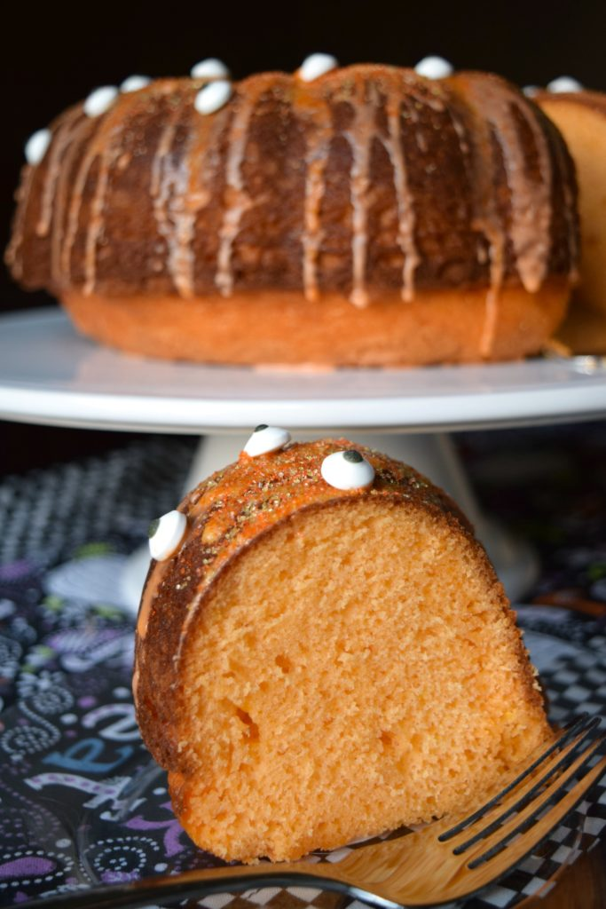 Boo! Make this super fun Orange You Scared? Halloween Cake. Wiith orange soda in the cake and the glaze plus spooky eyeballs it'll be the hit of your party!