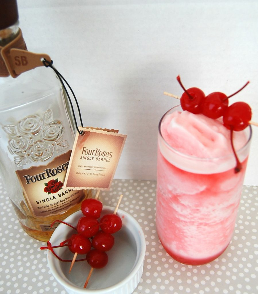 Cherry Bourbon Slush is a tasty frozen cocktail. Not your typical frozen drink - Cherry Bourbon Slush is a perfect party drink for summertime sipping!