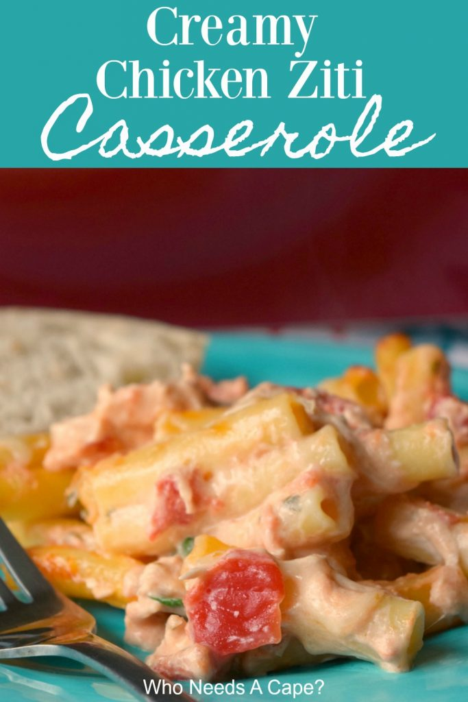 casserole with noodles, tomatoes and chicken on blue plate by red casserole pan