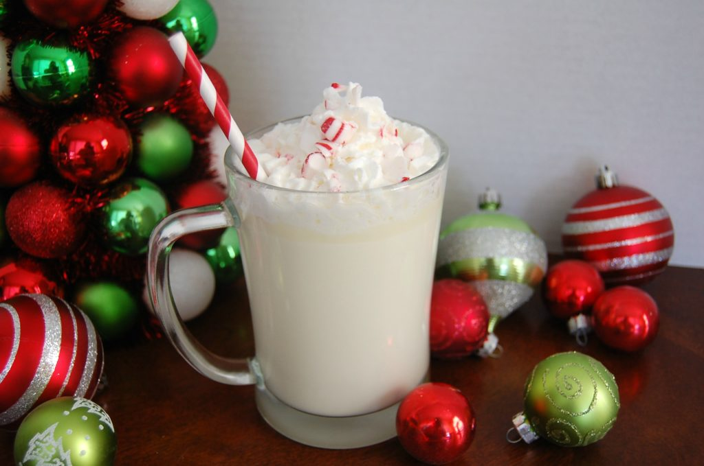 Slow Cooker White Mint Hot Chocolate is so easy to make homemade hot cocoa. Set it out for a snowy day or a hot cocoa bar! Great beverage for the holidays!