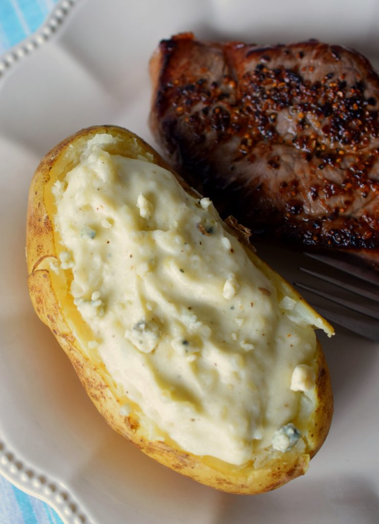 Break out of your side dish routine and make scrumptious Twice-Baked Blue Cheese Potatoes! Perfect with steak, you'll love these flavor packed spuds!