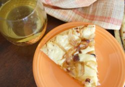 Caramelized Onion Flatbread is the perfect happy hour snack. With Gouda cheese and Onions this appetizer has a great combination of flavors for parties too!