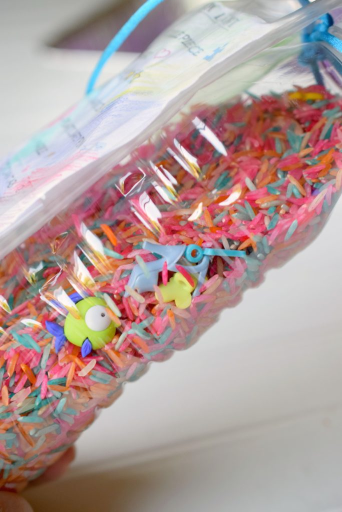 Reuse old water bottles and make a fun item for the beach bag. DIY Water Bottle I-Spy Games are so easy to make the kids can help on this crafty project.