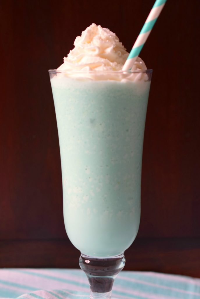 Boozy Blue Lagoon Milkshake is a delicious dessert cocktail that sweeps you away to the tropics. Make a batch for your next summer party!