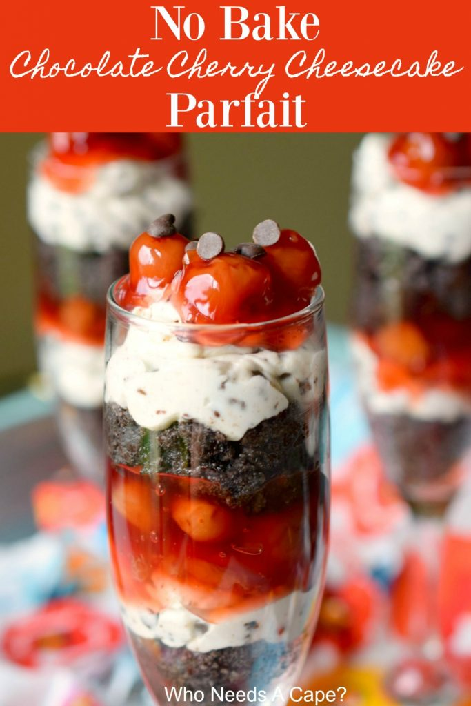 layered dessert with oreo, cheesecake, cherries in glass
