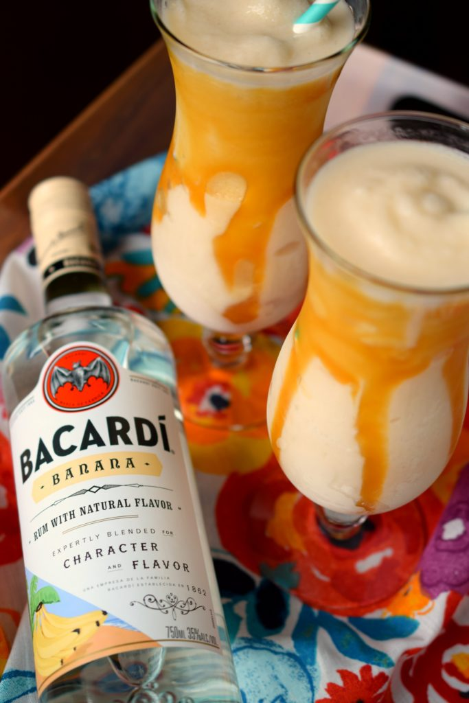 Sail away to warm tropical breezes with a refreshingly delicious Bananas Foster Colada. Easy to make this will be your new summer cocktail favorite!