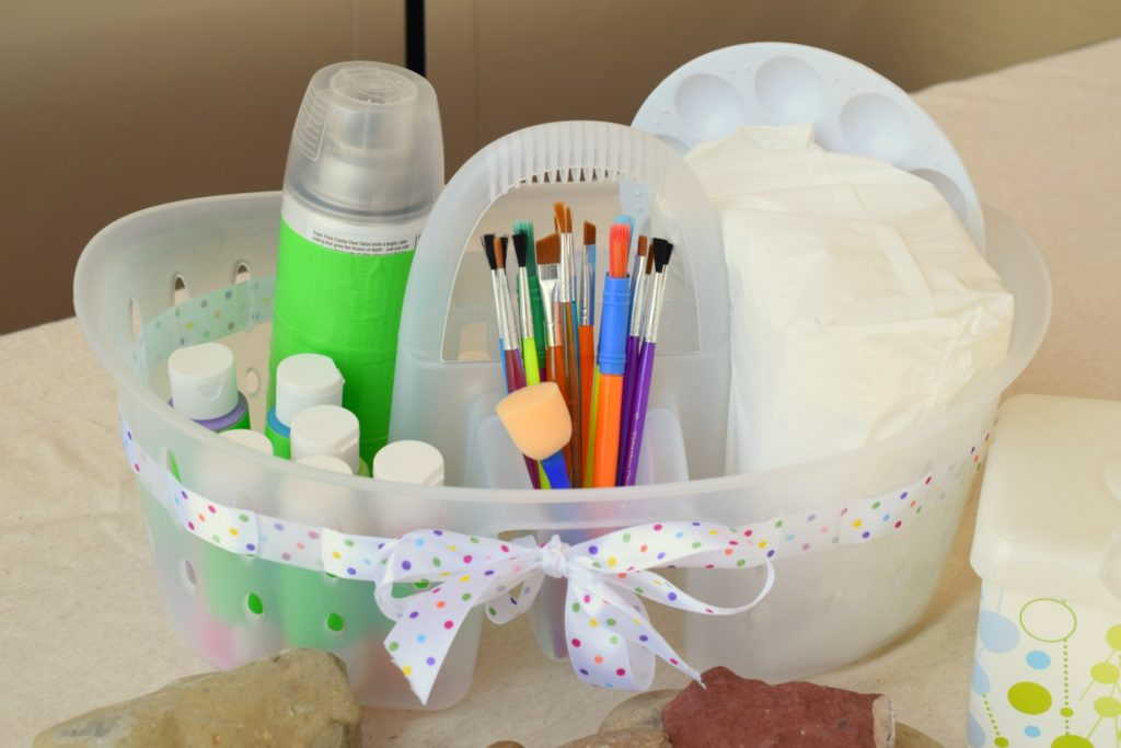 Enjoying the Rock Painting craze that's swept our nation? Make a Rock Painting Caddy to contain the craft supplies & find out what helps with the mess.