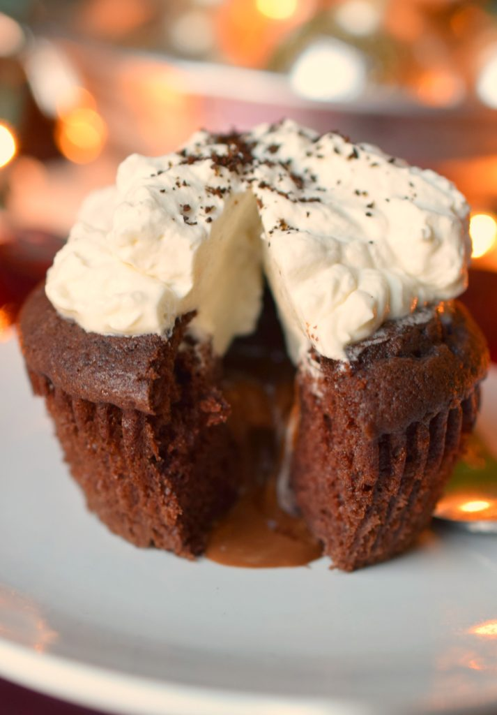 Warm Chocolate Melting Cupcakes are a decadently easy dessert perfect for the holidays! Topped with coffee infused whipped cream, you'll love this dessert!
