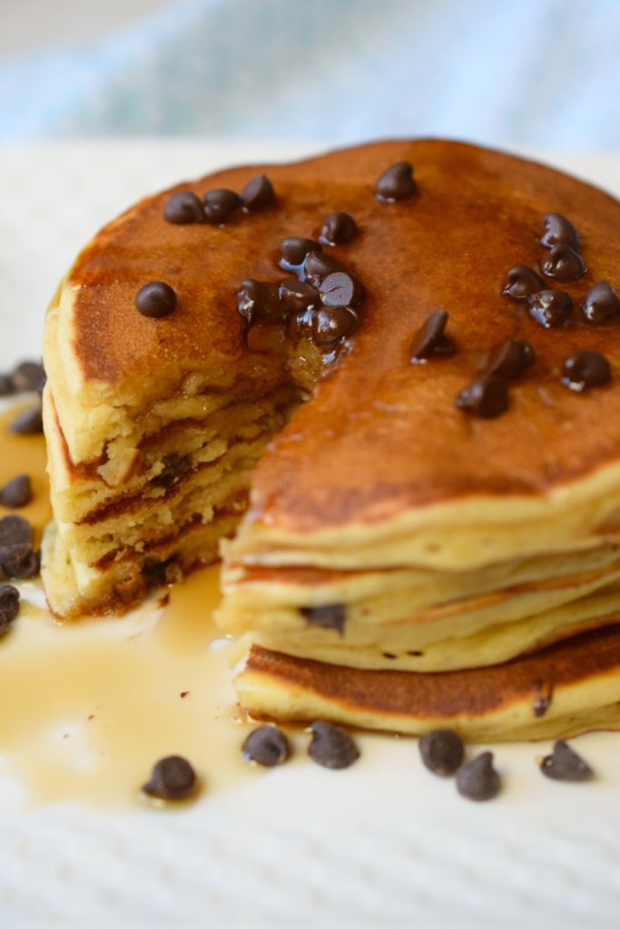 Delicious Peanut Butter Chocolate Chip Pancakes are simply wonderful. Your favorite flavors in this easy breakfast treat, great for holiday mornings!