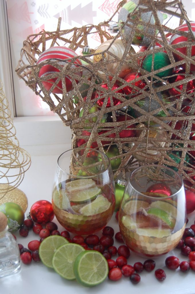 Serve yourself and your friends the best holiday cocktail - the Feliz Navidad Cocktail! A great blend of tequila, cranberry, and lime you'll LOVE IT!