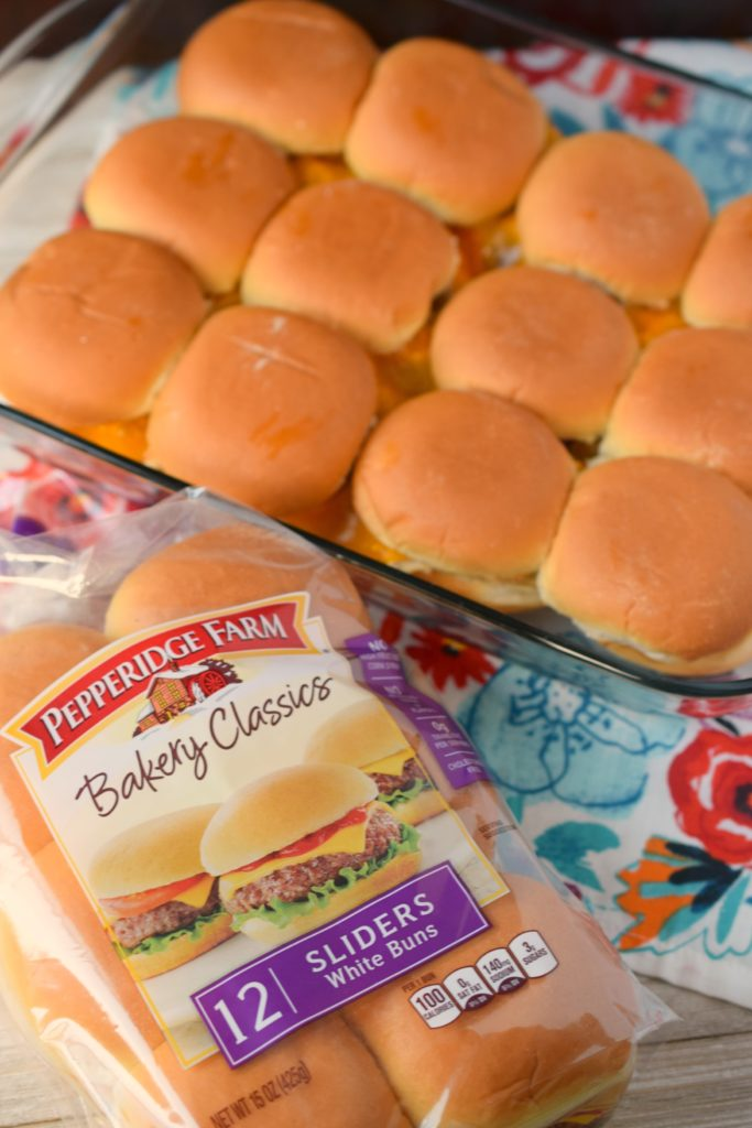 Slow Cooker Creamy Chicken & Bacon Sliders are the perfect game day meal! Easy to make, you'll love this crockpot comfort food that's perfect for a crowd.