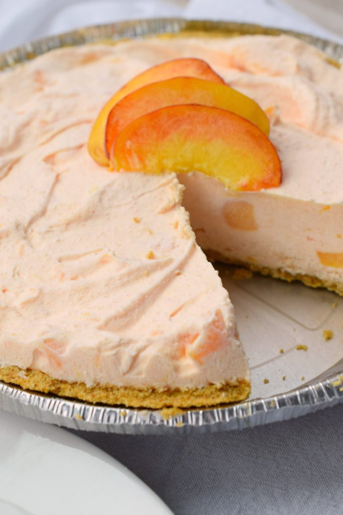 Why not combine a beloved cocktail and a dessert into one amazing pie? That's what you'll get with a Fuzzy Navel No Bake Cheesecake! YUM!