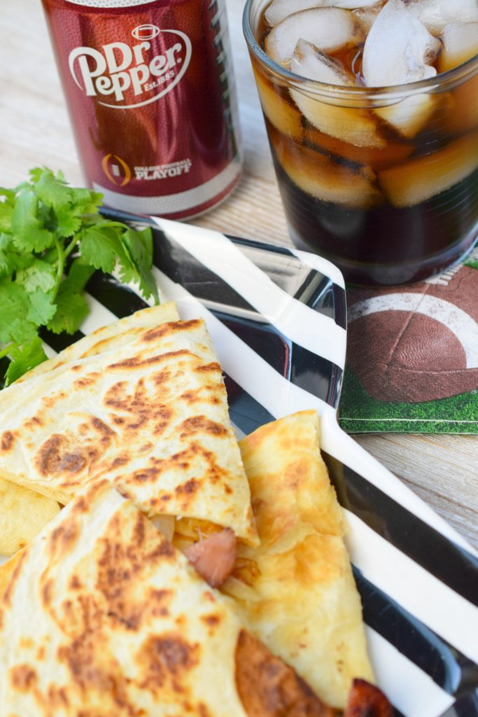 A Smoked Sausage Quesadilla is the perfect addition to homegating menus. Loaded with smoked sausage, pepper jack cheese & onions, it is simple & delicious.