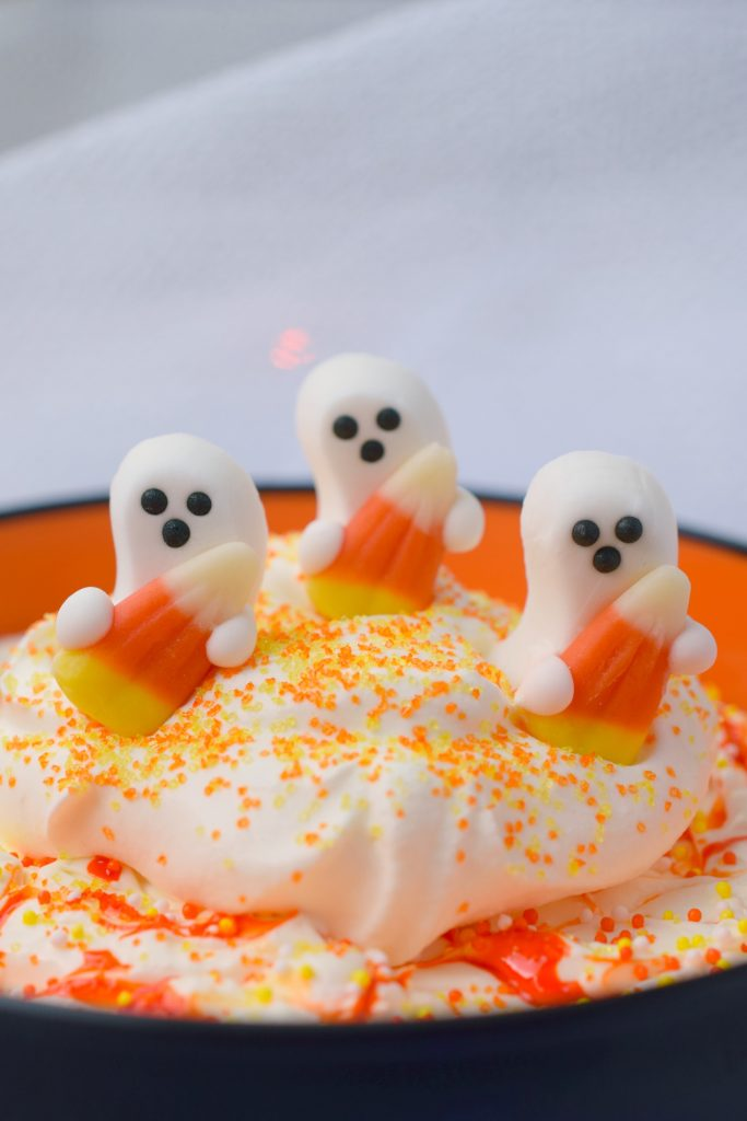 Having a Halloween party? You need Ghostly Gooey Dip, a sweet treat for kids of all ages. This easy to make dessert dip is great for parties.