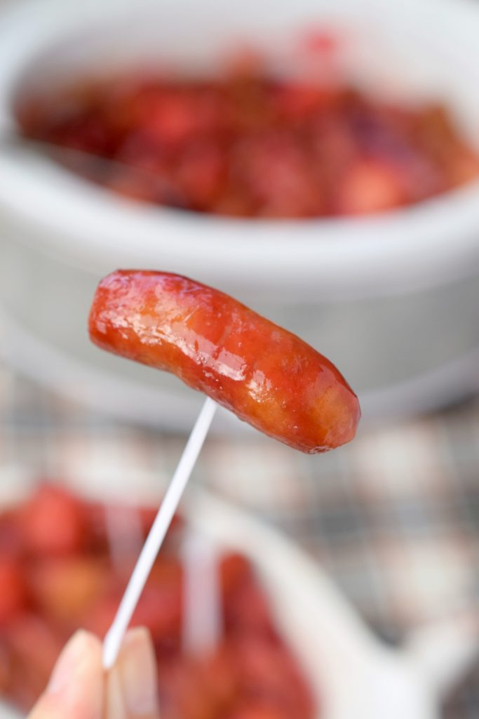 Saucy Slow Cooker Lit'l Smokies Smoked Sausages, an easy recipe that's perfect for holiday parties. You'll love the flavor of this crockpot appetizer.